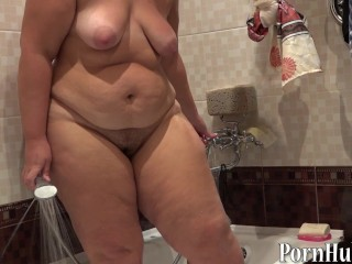 Plump Woman With Hairy By A Cunt, Pissing In A Bathroom
